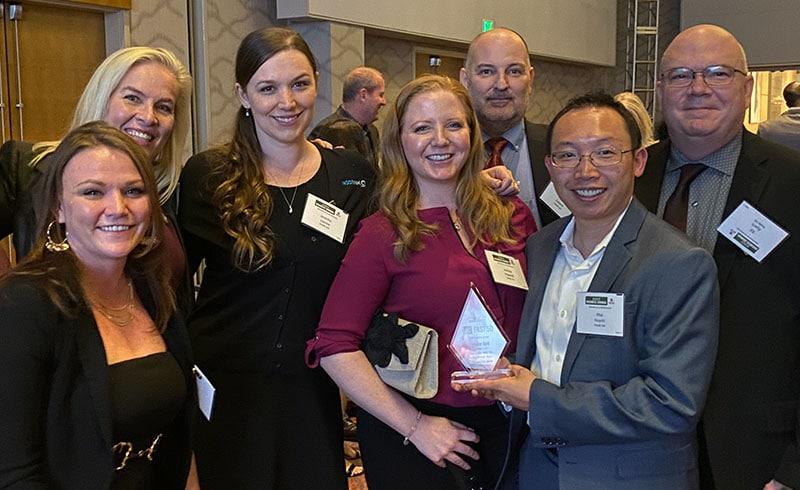 INODE execs with Fast 50 Award